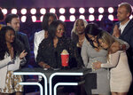 """FILE - Participants and crew from """"Surviving R. Kelly"""" accept the award for best documentary at the MTV Movie and TV Awards on June 15, 2019, in Santa Monica, Calif.  Accusers and others demanding accountability for the R&B superstar over allegations that he was abusing young women and girls for decades say it took so long to get to a guilty verdict in part because his targets were Black. Kelly was convicted Monday, Sept. 27, 2021, in his sex trafficking trial. Those who work against sexual violence say Black women and girls who want to speak out face a society that hypersexualizes them from a young age. (Photo by Chris Pizzello/Invision/AP, File)"""