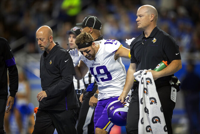 Minnesota Vikings wide receiver Adam Thielen (19) reacts after putting weight on his right leg, as he walks off the field with a hamstring injury in the first quarter of an NFL football game against the Detroit Lions, Sunday, Oct. 20, 2019, in Detroit. (Jerry Holt/Star Tribune via AP)