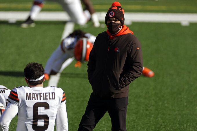 File-This Dec. 27, 2020, file photo shows Cleveland Browns head coach Kevin Stefanski talking to quarterback Baker Mayfield (60 before an NFL football game against the New York Jets, in East Rutherford, N.J. Stefanski isn't necessarily proud that he and his coaching staff have become proficient at working virtually. The Browns had their second day of remote meetings Tuesday after Cleveland's players _ along with numerous teams across the NFL _ decided to skip any in-person workouts for the time being due to the COVID-19 pandemic. (AP Photo/Adam Hunger, File)