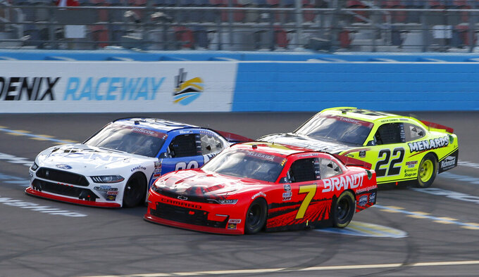 Justin Allgaier (7) and Chase Briscoe (98) race through Turn 4 ahead of Austin Cindric (22) during a NASCAR Xfinity Series auto race at Phoenix Raceway, Saturday, Nov. 7, 2020, in Avondale, Ariz. (AP Photo/Ralph Freso)