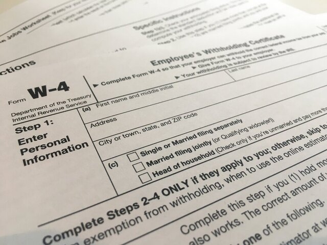This Wednesday, Feb. 5, 2020 photo shows the W-4 form in New York.  The IRS has introduced a new Form W-4 that must be used by all employers in 2020 to better accommodate recent changes to the tax law.  It's the biggest overhaul of the form in decades. It can require a bit more legwork but in return, the IRS says it will yield more accurate results.  (AP Photo/Patrick Sison)