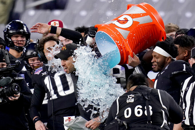 Iowa State head coach Matt Campbell is doused with liquid by his players during the final seconds of the Fiesta Bowl NCAA college football game against Oregon, Saturday, Jan. 2, 2021, in Glendale, Ariz. Iowa State won 34-17. (AP Photo/Ross D. Franklin)