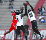 Hawaii defensive back Cortez Davis (18) breaks up a pass intended for New Mexico wide receiver Jay Griffin (23) while assisted by defensive back Eugene Ford (8) during the second half of an NCAA college football game on Saturday, Oct. 26, 2019, in Albuquerque, N.M. (AP Photo/Andres Leighton)