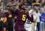 Arizona State quarterback Manny Wilkins throws a pass against the Stanford defense during the first half of an NCAA college football game Thursday, Oct. 18, 2018, in Tempe, Ariz. (AP Photo/Darryl Webb)