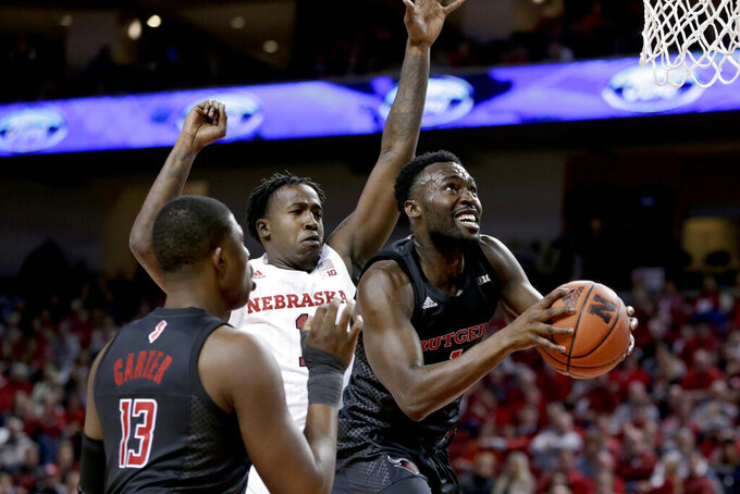 Rutgers' Akwasi Yeboah, right, goes to the basket in front of Nebraska's Kevin Cross (1), as Shaq Carter (13) watches during the first half of an NCAA college basketball game in Lincoln, Neb., Friday, Jan. 3, 2020. (AP Photo/Nati Harnik)