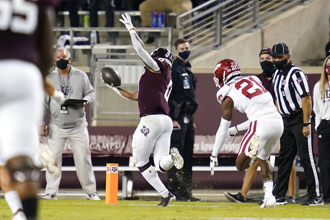 Texas A&M running back Ainias Smith (0) stays in bounds for a touchdown against Arkansas during the first quarter of an NCAA college football game Saturday, Oct. 31, 2020, in College Station, Texas. (AP Photo/Sam Craft)