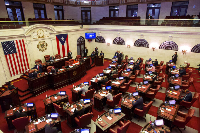 Senators meet concerning the confirmation of Pedro Pierluisi, currently the secretary of state, as new governor in San Juan, Puerto Rico, Monday, Aug. 5, 2019. Puerto Rico's Supreme Court on Monday agreed to rule on a lawsuit that the island's Senate filed in a bid to oust the veteran politician, Pierluisi, recently sworn in as the island's governor. (AP Photo/Dennis M. Rivera Pichardo)