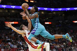 Charlotte Hornets guard Malik Monk, right, is fouled by Miami Heat forward Duncan Robinson during the first half of an NBA basketball game, Monday, Nov. 25, 2019, in Miami. (AP Photo/Lynne Sladky)