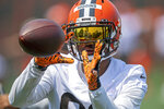 Cleveland Browns receiver Rashard Higgins (82) catches a pass during NFL football practice in Berea, Ohio, Wednesday, July 28, 2021. (AP Photo/David Dermer)