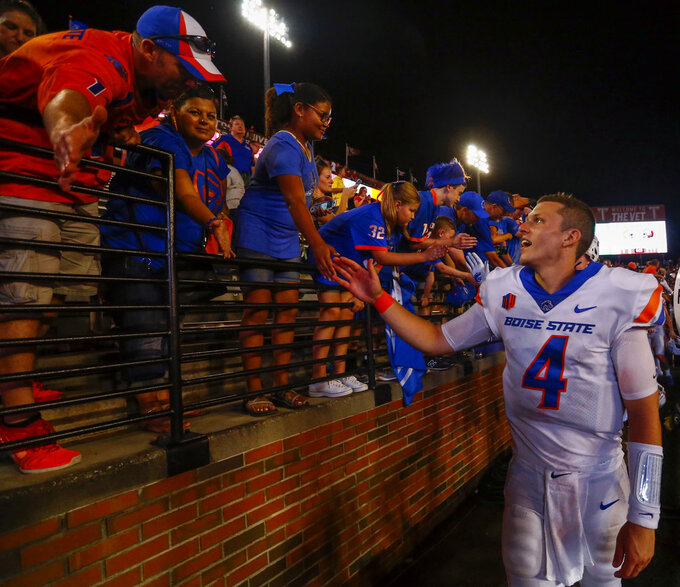 Boise State quarterback Brett Rypien (4) celebrates with fans after defeating Troy in an NCAA college football game, Saturday, Sept. 1, 2018, in Troy, Ala. (AP Photo/Butch Dill)