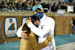 Coastal Carolina head coach Jamey Chadwell, right, hugs his wife Solmaz after an NCAA college football game against BYU Saturday, Dec. 5, 2020, in Conway, S.C. Coastal Carolina won 22-17. (AP Photo/Richard Shiro)