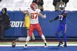 Kansas City Chiefs' Travis Kelce, left, celebrates his touchdown as Buffalo Bills' Tre'Davious White, right, looks on, during the first half of an NFL football game, Monday, Oct. 19, 2020, in Orchard Park, N.Y. (AP Photo/Adrian Kraus)