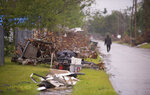 Piles of debris from Hurricane Laura still line the streets of Lake Charles as residents prepare for Hurricane Delta  on Friday, Oct. 9, 2020.  Delta is expected to make landfall late Friday. (Chris Granger/The Advocate via AP)