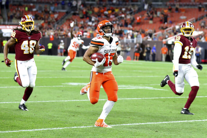 "FILE - In this Aug. 8, 2019, file photo, Cleveland Browns' Damon Sheehy-Guiseppi (15) runs 86-yards for a touchdown on a punt return during the second half of the team's NFL preseason football game against the Washington Redskins, in Cleveland. ""I just saw the hole,"" he said afterward surrounded by reporters. ""I ran as fast as I could to the hole and tried to take off."" (AP Photo/Ron Schwane)"