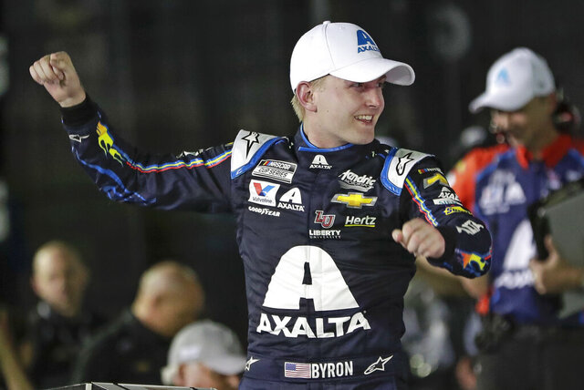 FILE - In this Feb. 13, 2020, file photo, William Byron celebrates in Victory Lane after winning the second of two NASCAR Daytona 500 qualifying auto races at Daytona International Speedway in Daytona Beach, Fla. Byron has won NASCAR's iRacing event at virtual Dover International Speedway. It is Byron's third victory in the last four iRacing events created to provide NASCAR content during the coronavirus pandemic. (AP Photo/John Raoux, File)