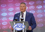 Virginia Tech head coach Justin Fuente speaks during the Atlantic Coast Conference NCAA college football media days in Charlotte, N.C., Thursday, July 18, 2019. (AP Photo/Chuck Burton)
