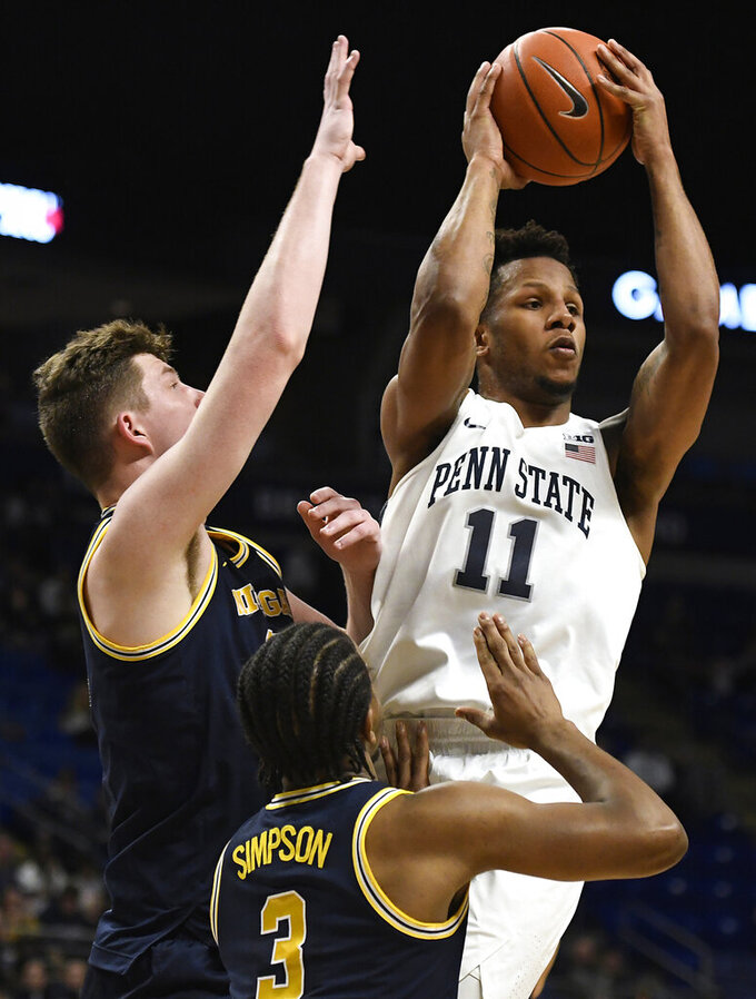 FILE - In this Feb. 12, 2019, file photo, Penn State forward Lamar Stevens (11) shoots over Michigan guard Zavier Simpson (3) during the first half of an NCAA college basketball game in State College, Pa. Stevens could've gone pro a few months ago. Instead, he returned to a team that finished last season as one of the hottest in the country after starting as one of the worst. (AP Photo/John Beale, File)