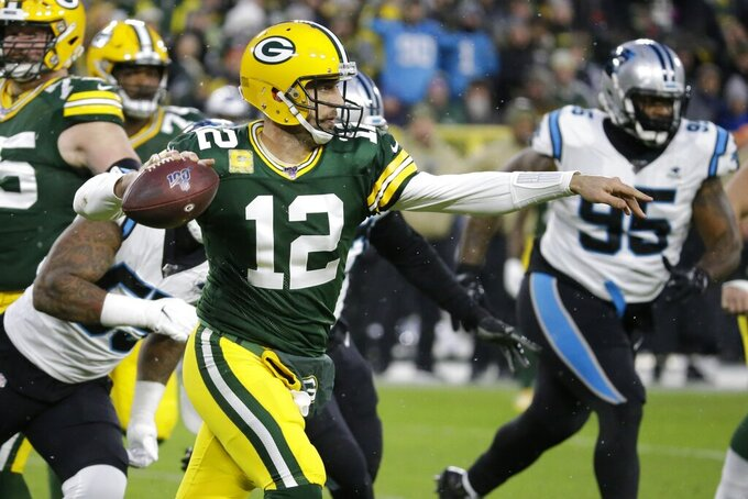 Green Bay Packers' Aaron Rodgers looks to pass during the first half of an NFL football game against the Carolina Panthers Sunday, Nov. 10, 2019, in Green Bay, Wis. (AP Photo/Mike Roemer)