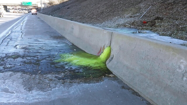 This photo provided by Michigan Department of Transportation toxic chemical substances leaked along Interstate 696 in Madison Heights, Mich., on Dec. 20, 2019. The discovery led to an investigation of an old industrial site near the interstate. State regulators said high levels of multiple contaminants have been found in soil and groundwater around the former Electro-Plating Services.  (Michigan Department of Transportation via AP)