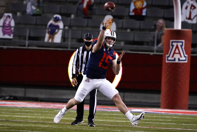 Arizona State quarterback Daylin McLemore (15) throws a pass against Arizona State during the first half of an NCAA college football game, Friday, Dec. 11, 2020, in Tucson, Ariz. (AP Photo/Rick Scuteri)