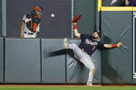 Washington Nationals right fielder Adam Eaton can't get a glove on a RBI-double by Houston Astros' George Springer during the eighth inning of Game 1 of the baseball World Series Tuesday, Oct. 22, 2019, in Houston. (AP Photo/Matt Slocum)