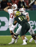 Wisconsin quarterback Jack Coan (17) throws a pass against South Florida during the second half of an NCAA college football game Friday, Aug. 30, 2019, in Tampa, Fla. (AP Photo/Chris O'Meara)