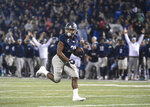 Georgia Southern running back Wesley Fields (21) looks back while running for a touchdown against Appalachian State during the fourth quarter of an NCAA college football game Thursday, Oct. 25, 2018, in Statesboro, Ga. (AP Photo/John Amis)