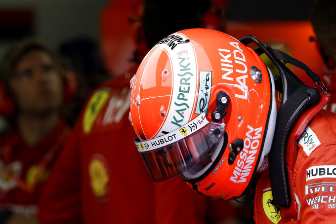 The name of three-time Formula One world champion Niki Lauda is written on the helmet of Ferrari driver Sebastian Vettel of Germany during the second practice session at the Monaco racetrack, in Monaco, Thursday, May 23, 2019. Three-time Formula One world champion Niki Lauda, who won two of his titles after a horrific crash that left him with serious burns and went on to become a prominent figure in the aviation industry, has died on May 21, 2109. He was 70. (AP Photo/Luca Bruno)