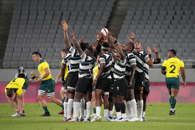 Fiji players huddle up at the start of their men's rugby sevens quarterfinal match against Australia, at the 2020 Summer Olympics, Tuesday, July 27, 2021 in Tokyo, Japan. (AP Photo/Shuji Kajiyama)