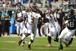 Tampa Bay Buccaneers quarterback Jameis Winston (3) looks for a receiver as he scrambles away from Jacksonville Jaguars outside linebacker Leon Jacobs (48) during the first half of an NFL football game, Sunday, Dec. 1, 2019, in Jacksonville, Fla. (AP Photo/John Raoux)