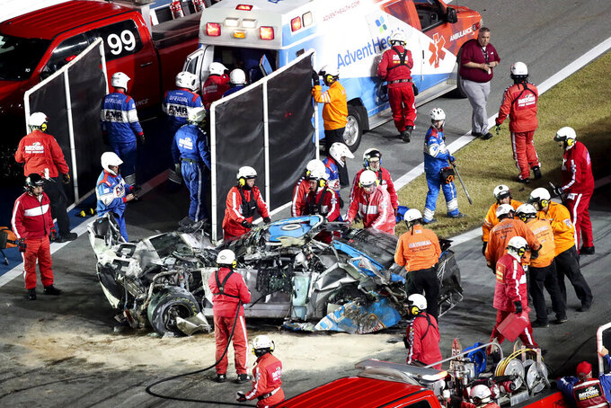 Ryan Newman is moved to an ambulance after rescue workers removed him from his car after he was involved in a crash on NASCAR Daytona 500 auto race at Daytona International Speedway, Monday, Feb. 17, 2020, in Daytona Beach, Fla. Sunday's race was postponed because of rain. (AP Photo/David Graham)
