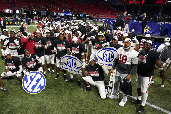 Alabama players celebrate victory against Florida after the Southeastern Conference championship NCAA college football game, Sunday, Dec. 20, 2020, in Atlanta. Alabama won 52-46. (AP Photo/Brynn Anderson)
