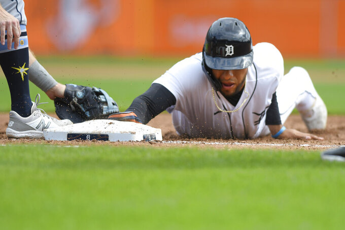 Detroit Tigers' Victor Reyes slides safely back to first base on a pickoff-attempt in the third inning of a baseball game against the Tampa Bay Rays, Sunday, Sept. 12, 2021, in Detroit. (AP Photo/Jose Juarez)