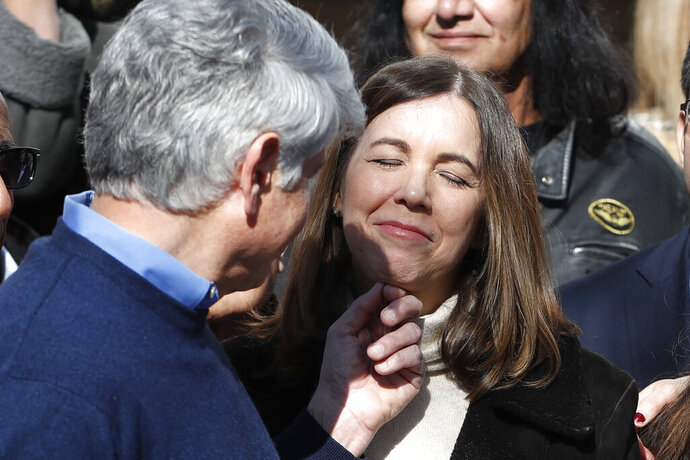 Patti Blagojevich smiles as her husband, former Illinois Gov. Rod Blagojevich touches her chin during a news conference outside his home Wednesday, Feb. 19, 2020, in Chicago, the morning after President Donald Trump on Tuesday, commuted Blagojevich's 14-year prison sentence for political corruption. (AP Photo/Charles Rex Arbogast)