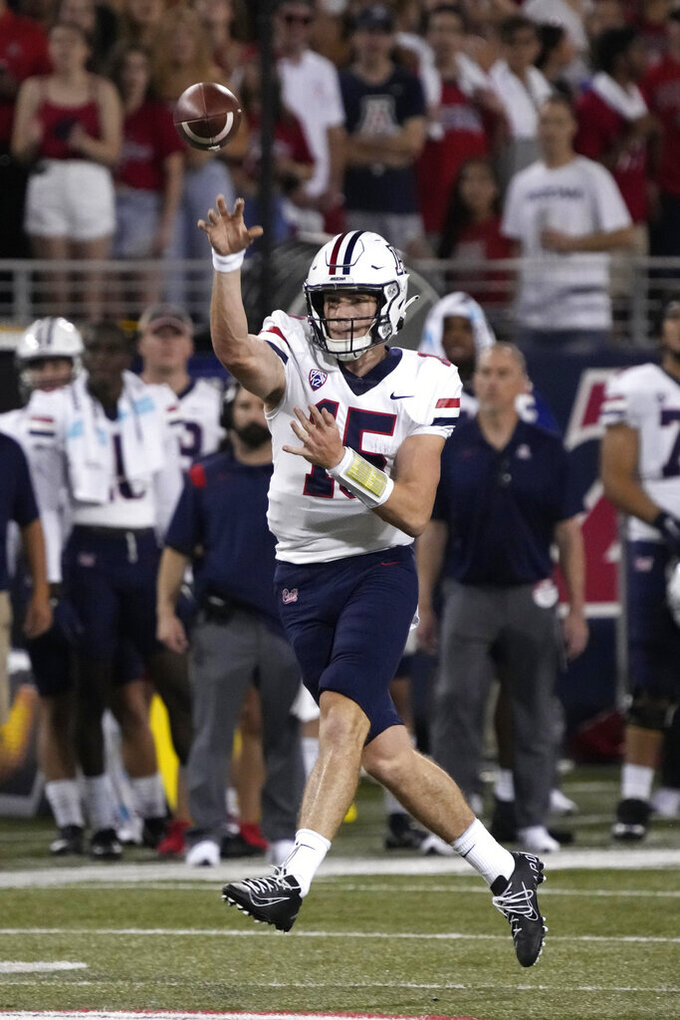 Arizona quarterback Will Plummer throws off balance against Northern Arizona during the first half of an NCAA college football game, Saturday, Sept. 18, 2021, in Tucson, Ariz. (AP Photo/Rick Scuteri)
