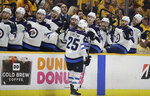 Winnipeg Jets center Paul Stastny (25) is congratulated after scoring against the Nashville Predators during the third period in Game 7 of an NHL hockey second-round playoff series Thursday, May 10, 2018, in Nashville, Tenn. The Jets won 5-1 and advanced to the Western Conference final. (AP Photo/Mark Humphrey)