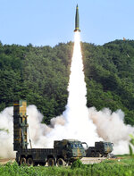 FILE - In this July 5, 2017, file photo, provided by the South Korea Defense Ministry, South Korea's Hyunmoo Missile II is fired during the combined military exercise between U.S. and South Korea at an undisclosed location in South Korea. South Korea said Tuesday, July 28, 2020, it has won U.S. consent to use solid fuel for space launch vehicles, a move that experts say would enable Seoul to launch its first surveillance satellites and accumulate technology to build more powerful missiles. (South Korea Defense Ministry via AP, File)