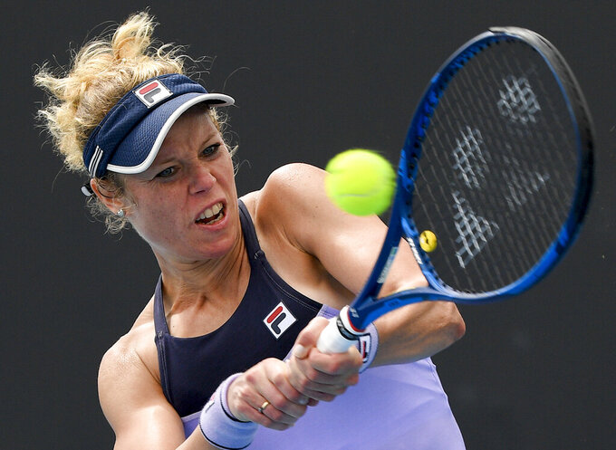 Germany's Laura Siegmund makes a backhand return to Kazakhstan's Zarina Diyas during a tuneup tournament ahead of the Australian Open tennis championships in Melbourne, Australia, Monday, Feb. 1, 2021. (AP Photo/Andrew Brownbill)
