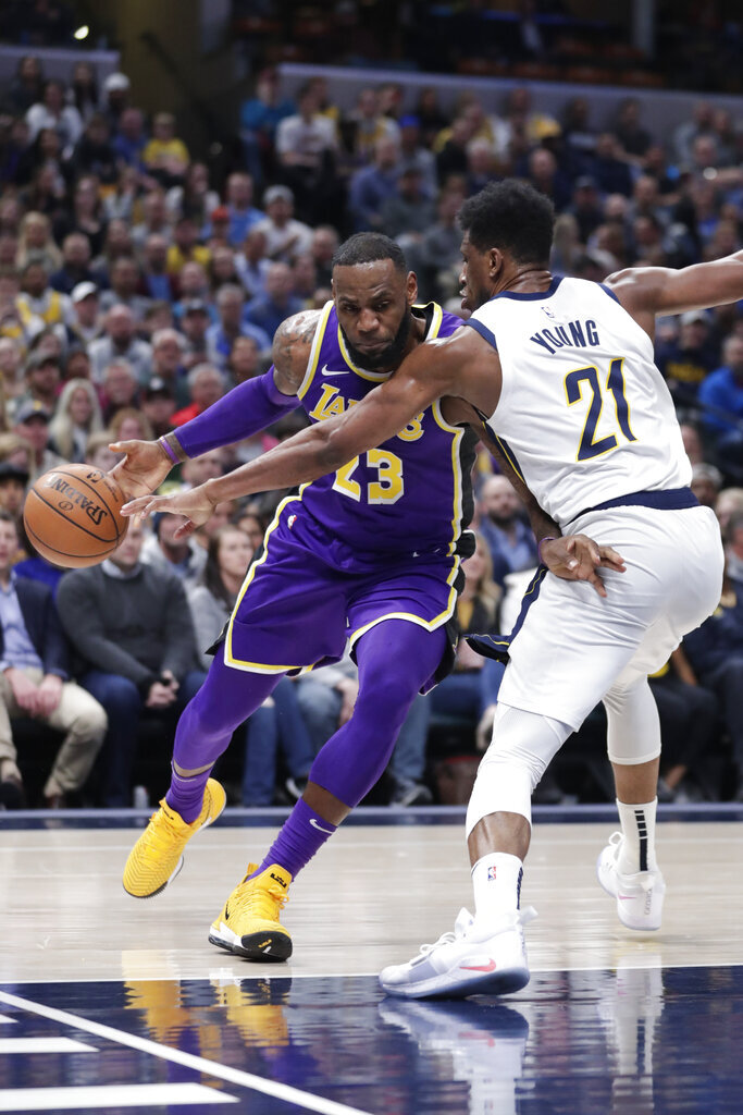 Los Angeles Lakers forward LeBron James (23) drives on Indiana Pacers forward Thaddeus Young (21) during the first half of an NBA basketball game in Indianapolis, Tuesday, Feb. 5, 2019. (AP Photo/Michael Conroy)