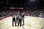 Officials confer after an NBA summer league basketball game between the New York Knicks and the New Orleans Pelicans was stopped following an earthquake Friday, July 5, 2019, in Las Vegas. (AP Photo/Steve Marcus)