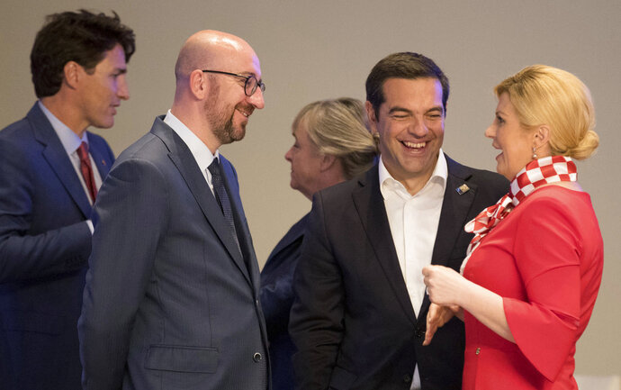 From left, Canadian Prime Minister Justin Trudeau, Belgian Prime Minister Charles Michel, Greek Prime Minister Alexis Tsipras and Croatian President Kalinda Grabar-Kitarovic speak prior to a dinner of NATO heads of state and government at Park Cinquantenaire in Brussels on Wednesday, July 11, 2018. NATO leaders gathered in Brussels Wednesday for a two-day summit to discuss Russia, Iraq and their mission in Afghanistan. (Benoit Doppagne, Pool Photo via AP)