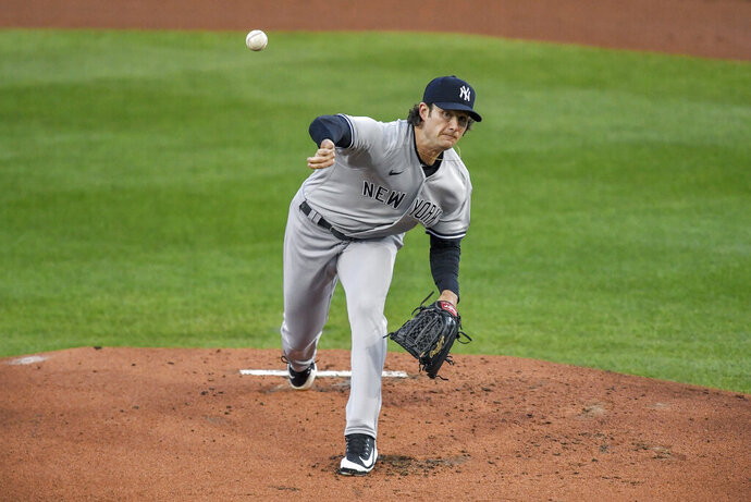 New York Yankees starting pitcher Gerrit Cole throws to a Toronto Blue Jays batter during the first inning of a baseball game in Buffalo, N.Y., Tuesday, Sept. 22, 2020. (AP Photo/Adrian Kraus)