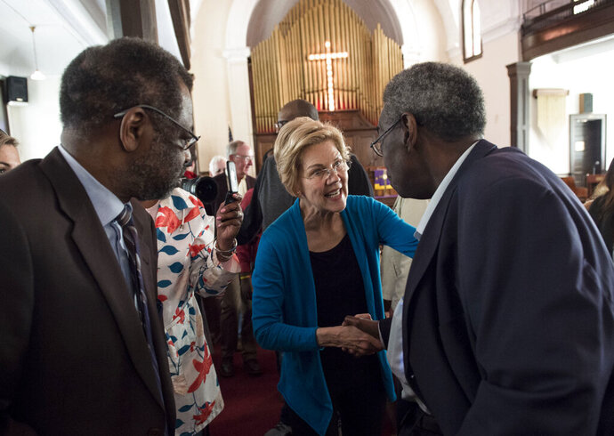 Democratic presidential candidate Sen. Elizabeth Warren, D-Mass., shakes hands with Alabama State Sen. Henry Sanders at the Brown Chapel AME Church in Selma, Ala., on Tuesday, March 19, 2019.  Democrats' road back to the White House runs through the Republican-run South, and not just in the early nominating state of South Carolina. (Jake Crandall/The Montgomery Advertiser via AP)