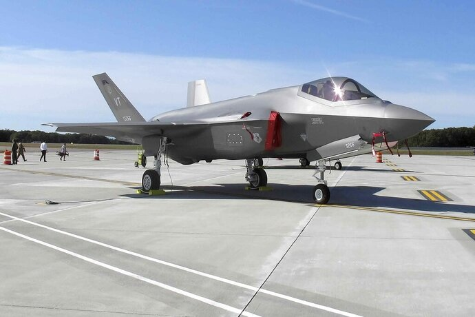 FILE - In this Sept. 19, 2019 file photo, an F-35 fighter jet arrives at the Vermont Air National Guard base in South Burlington, Vt., United States. Israeli Defense Minister Benny Gantz is headed to Washington on Monday, Sept. 21, 2020, for talks with his U.S. counterpart on maintaining Israel's qualitative military edge in the Middle East following its historic normalization agreement with the United Arab Emirates. Since the agreement was announced last month, the UAE has made no secret about its desire to acquire F-35 warplanes and other advanced U.S.-made weaponry. (AP Photo/Wilson Ring, File)