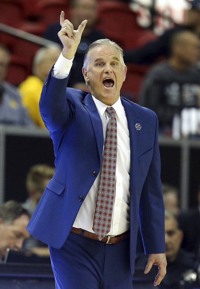 San Diego State head coach Brian Dutcher instructs his team during the second half of an NCAA college basketball game against UNLV in the Mountain West Conference men's tournament Thursday, March 14, 2019, in Las Vegas. (AP Photo/Isaac Brekken)