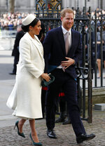FILE - In this file photo dated Monday, March 11, 2019, Britain's Prince Harry and Meghan Markle, the Duchess of Sussex arrive to attend the Commonwealth Service at Westminster Abbey on Commonwealth Day in London.  Prince Harry on Monday May 6, 2019, said Meghan has given birth to a baby boy.(AP Photo/Frank Augstein, FILE)