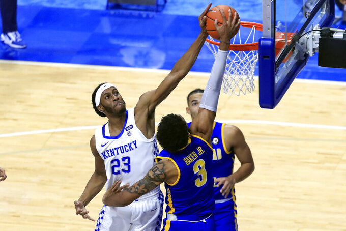 Morehead State's James Baker (3) has his shot blocked by Kentucky's Isaiah Jackson (23) during the first half of an NCAA college basketball game in Lexington, Ky., Wednesday, Nov. 25, 2020. (AP Photo/James Crisp)