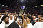San Diego State players hold up the Mountain West Championship trophy after beating New Mexico 82-59 in an NCAA college basketball game, Tuesday, Feb. 11, 2020, in San Diego. (AP Photo/Denis Poroy)