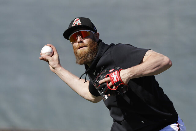 Arizona Diamondbacks' Archie Bradley throws during spring training baseball practice, Sunday, Feb. 16, 2020, in Scottsdale, Ariz. (AP Photo/Darron Cummings)