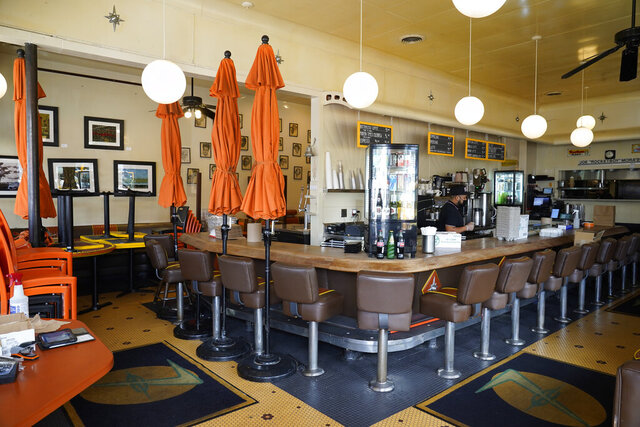 The Fred 62 restaurant is open for takeout and delivery in the Los Feliz neighborhood of Los Angeles Monday, Jan. 25, 2021. California has lifted regional stay-at-home orders statewide in response to improving coronavirus conditions. Public health officials said Monday that the state will return to a system of county-by-county restrictions intended to stem the spread of the virus. Local officials could choose to continue stricter rules. The state is also lifting a 10 p.m. to 5 a.m. curfew. (AP Photo/Damian Dovarganes)